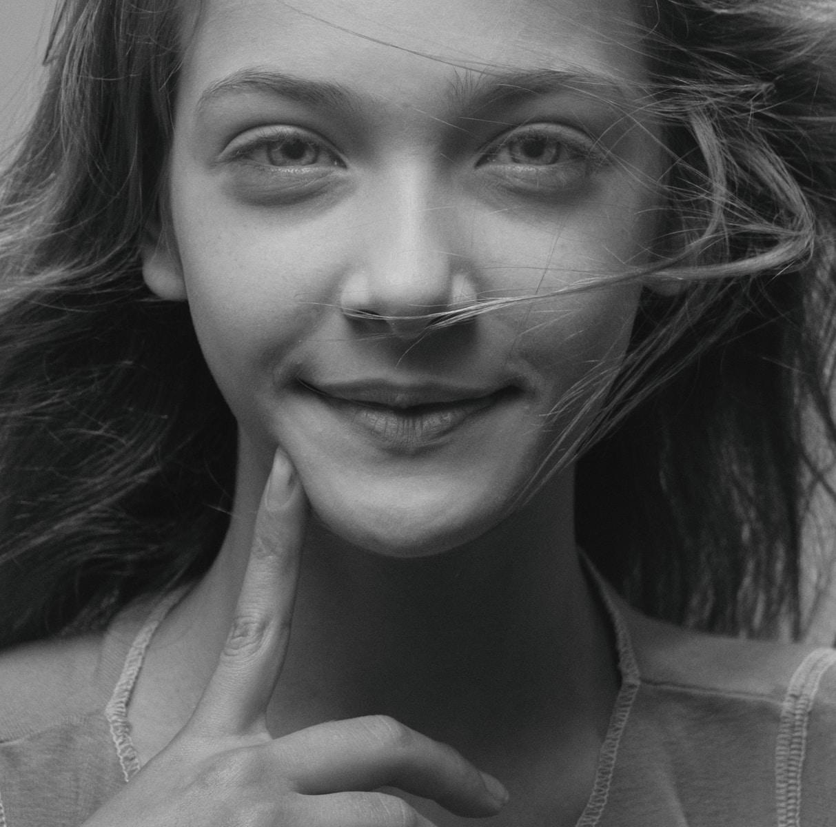 woman in tank top smiling